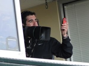AT&T Park.  Cameraman and his Cell Phone.